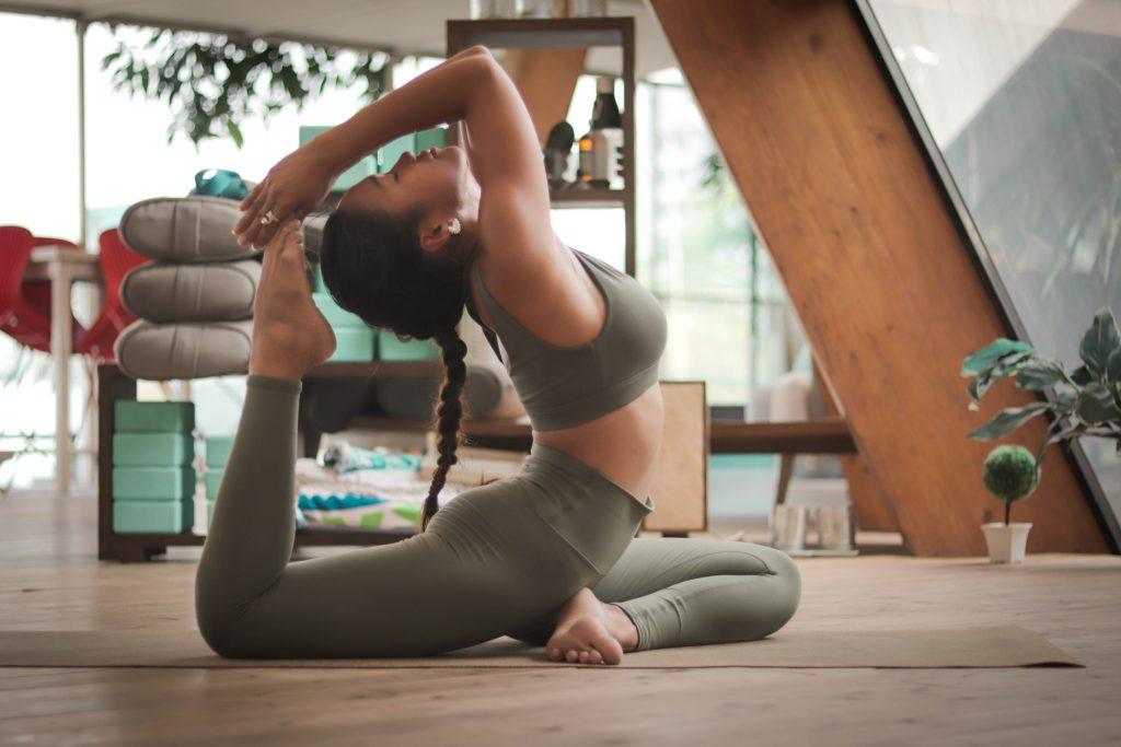 Female bending backwards stretching at home